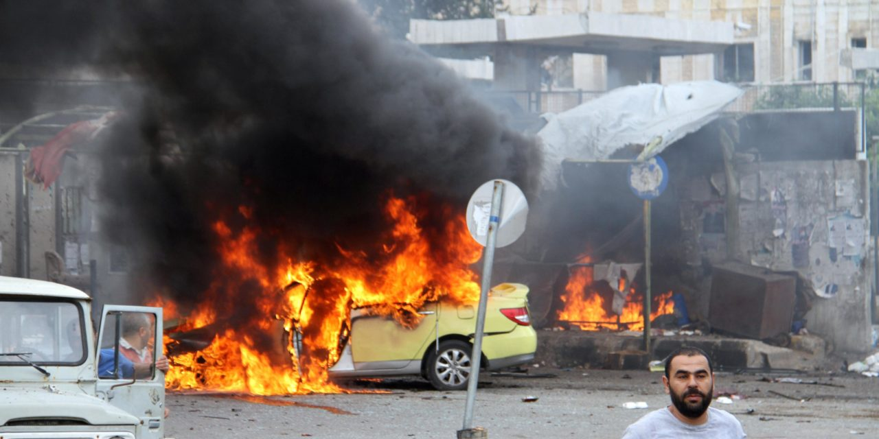 Scores dead in Isis assaults on Syrian seaside cities