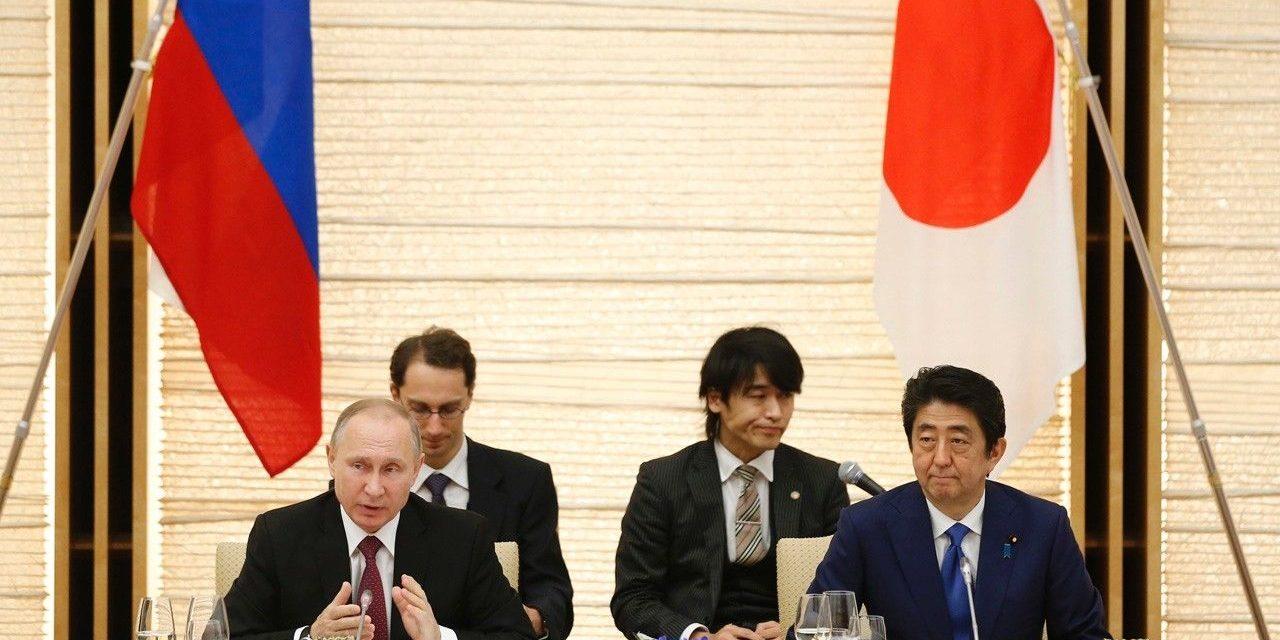 Japan, Russia indication financial development deals; standoff on district