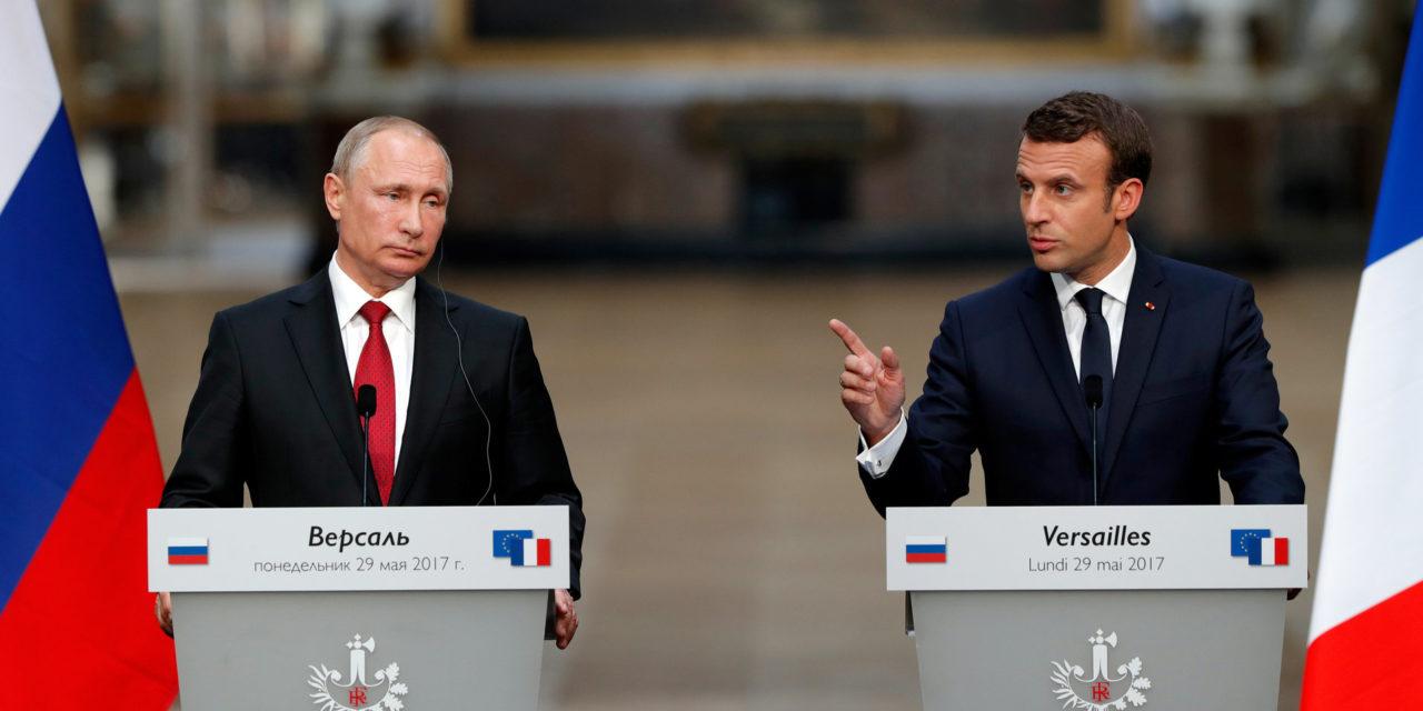 Macron, Alongside Putin, Denounces Russian Media Outlets For Election Meddling