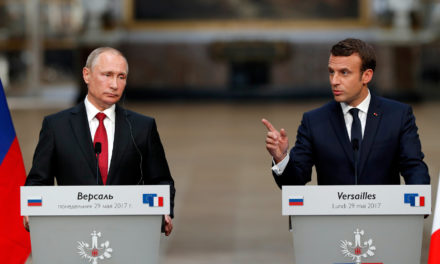 Macron, Alongside Putin, Denounces Russian Media Outlets For Election Meddling