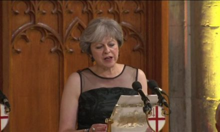 May implicates Putin of political election meddling