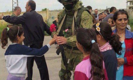 Syrian little girl dedicating a Russian soldier a blossom.