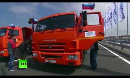 Putin drives vehicle to open up debatable Russia to Crimea bridge