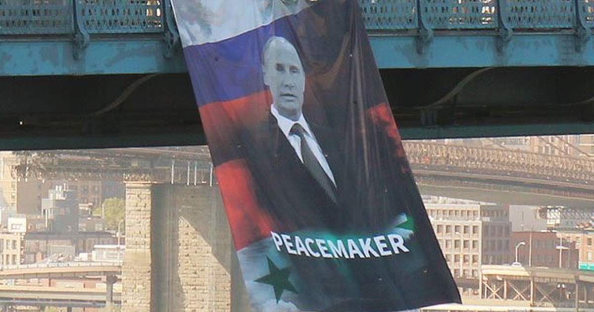 Putin offered up on a massive banner in New York City