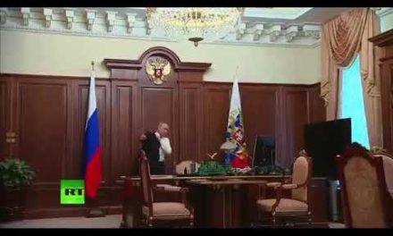 Russian President Vladimir Putin leaving Kremlin to his auto. Almost fifty percent kilometres range. What a spect