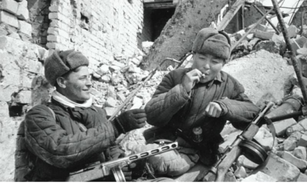 A Kazakh and also a Russian share a cigarette after a fight in Stalingrad