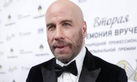 Why Is John Travolta Palling Around With Putins Crony in Russia?