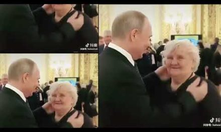 Putin hugs educator, hangs around with her in spite of hectic timetable