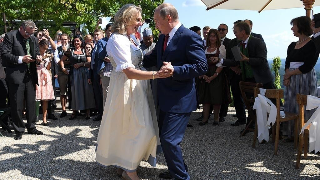 Controversial wedding celebration visitor Vladimir Putin dancings with Austria's international preacher on her special day